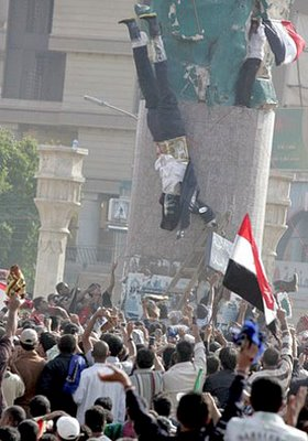 Iraqi Protesters Burn George Bush Effigy where Saddam Hussein Statue Once Stood