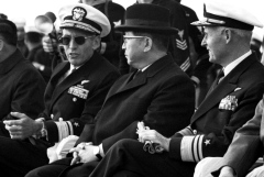 South Korean Prime Minister Chung Il Kwon is flanked by his hosts, Rear Adm. George S. Morrison, left, commander of Carrier Division Nine, and Vice Adm. William F. Bringle, commander of the U.S. 7th Fleet in the Pacific, as they watch jets from Air Wing 21 take off and land on the deck of the carrier USS Hancock.