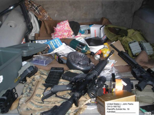Weapons and ammunition recovered by authorities during the investigation into John Christian Parks, pictured in a Department of Justice photo. Photo: Department Of Justice